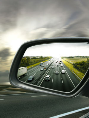Car side mirror with view of traffic